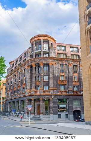 YEREVAN ARMENIA - MAY 29 2016: The Tufenkian Historic Hotel occupied the scenic mansion of black and orange local stone it's located next to the Republic Square on May 29 in Yerevan.