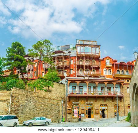 TBILISI GEORGIA - MAY 28 2016: The hilly neighborhood of Metekhi Church is popular among the tourists here located family hotels nice cafes and wine boutiques on May 28 in Tbilisi.