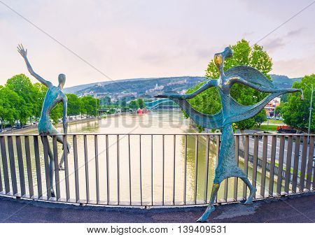 TBILISI GEORGIA - MAY 28 2016: The Baratashvili Bridge decorated with the bronze sculptures of Ali and Nino - the famous literary heroes on May 28 in Tbilisi.