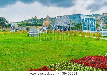 TBILISI GEORGIA - MAY 28 2016: The modern Cableway station in Rike Park with the medieval Metekhi Church and Tabor Monastery on the background on May 28 in Tbilisi.