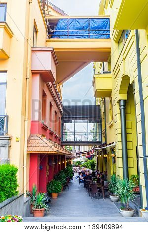 TBILISI GEORGIA - MAY 28 2016: The cozy cafes in narrow shady street of the old town on May 28 in Tbilisi.