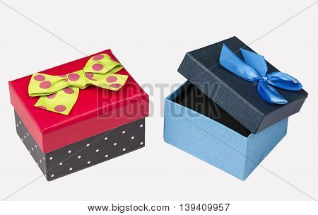 Funny red black gift box with green ribbon and Blue Gift box with ribbon isolated on white