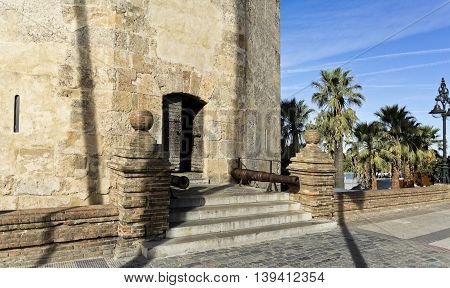 Detail of the small entry door to the Torre del Oro (Tower of the Gold) a dodecagonal military watchtower in Seville Spain.