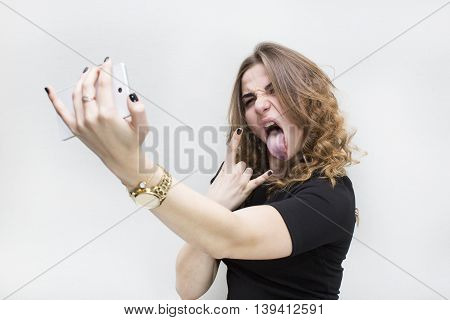 Girl doing self phone on a white background