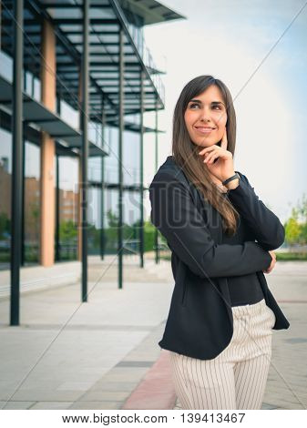 Business woman outside her office looking at left side