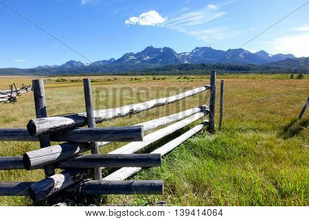 Idaho's Sawtooth mountains provide a beautiful background for grassy meadows and crooked-rail fences.