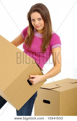 Woman packing/unpacking boxes during a relocation