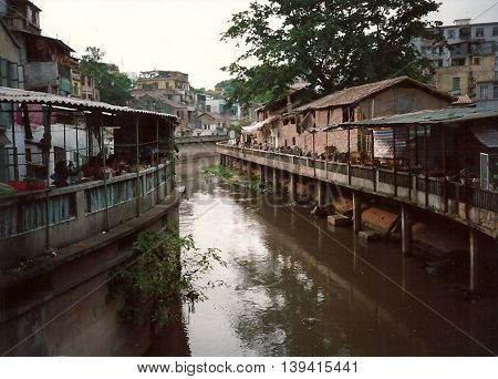 A canal flows through Guangzhou, China, circa 1987.