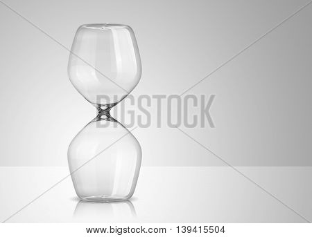 Photo of empty hourglass on gray background