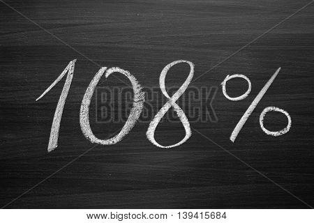 108 percent header written with a chalk on the blackboard