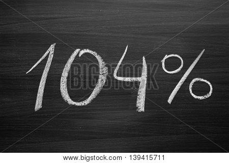 104 percent header written with a chalk on the blackboard