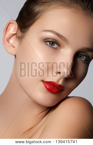 Beauty Model Girl With Perfect Make-up Looking At Camera