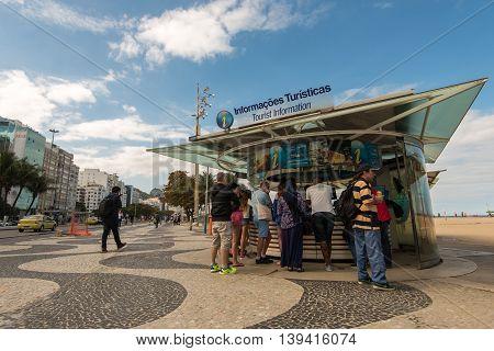 Rio de Janeiro, Brazil - July 18, 2016: Tourist information kiosk in Copacabana beach always have visitors around.
