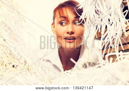 Ecology Concept. Young Woman With Shredded Paper. Focus On Face