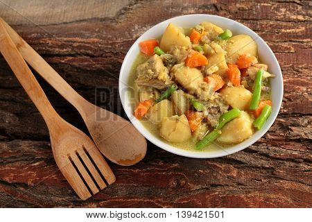 Tasty mutton stew in a white bowl,