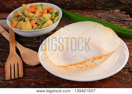 South Indian cuisine Appam with mutton stew