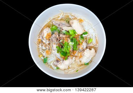Chicken Noodle Soup in bowl on black background