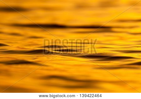 gold sea with waves in the morning