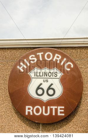 Round sign on a building for Historic Illinois US Route 66