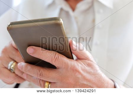 image of Senior woman using smart phone