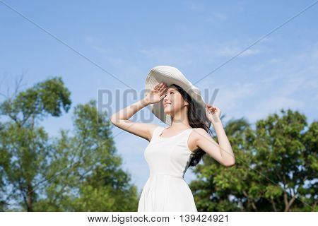 young woman wear dress and smile with nature green background