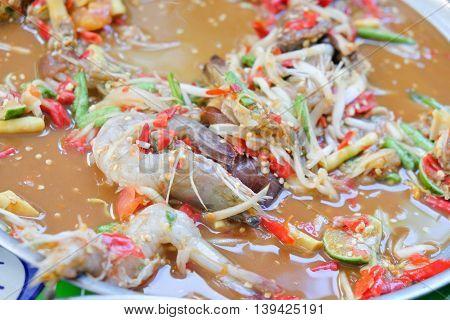 Thai papaya salad Som Tum with pickled fish and shrimp