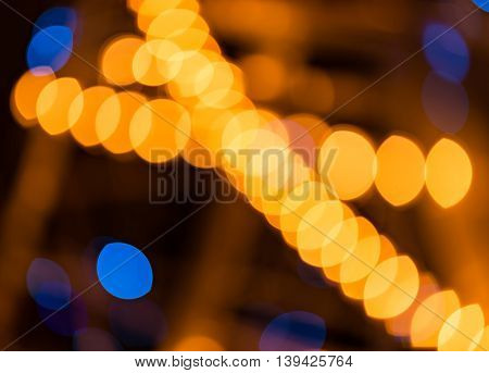 Abstract golden and blue background circular bokeh out of focus lights