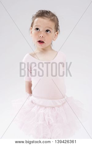 Cute Little Caucasian Blond Child with Curious Expression Looking Upwards.Vertical Image Orientation