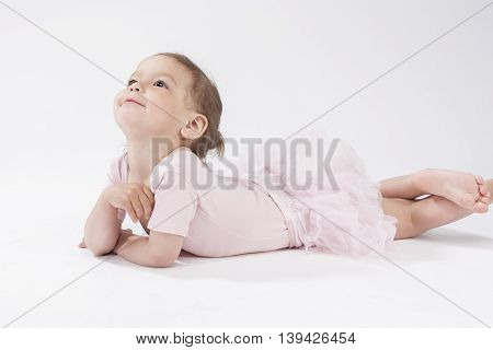 Portrait of Little Cute Dreaming Child In Studio Environment. Posing Against White Background.Horizontal Image Orientation