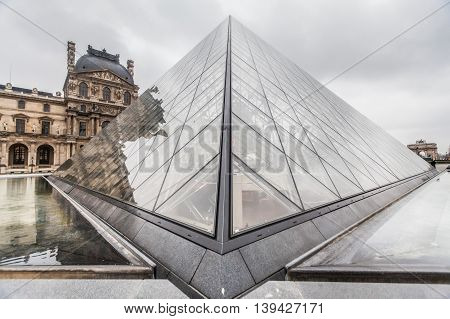 Paris France, 3 December 2014:  The Louvre Museum is the world's largest museum and a historic monument in Paris, France. A central landmark of the city, it is located on the Right Bank of the Seine in the 1st arrondissement.