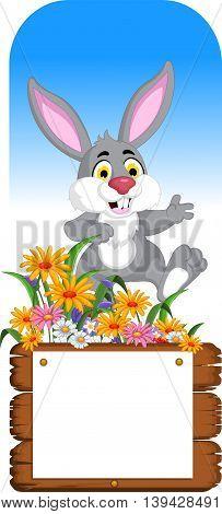 funny rabbit cartoon posing with blank board