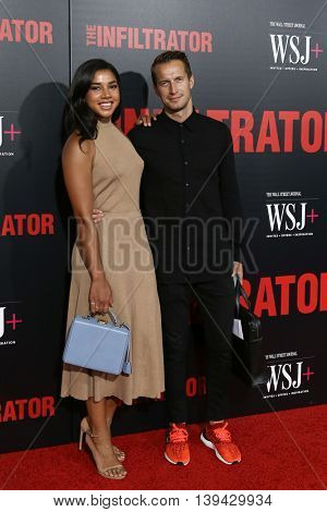 NEW YORK-JULY 11: Hannah Bronfman (L) and Brendan Fallis attend 'The Infiltrator' New York premiere at AMC Loews Lincoln Square 13 Theater on July 11, 2016 in New York City.