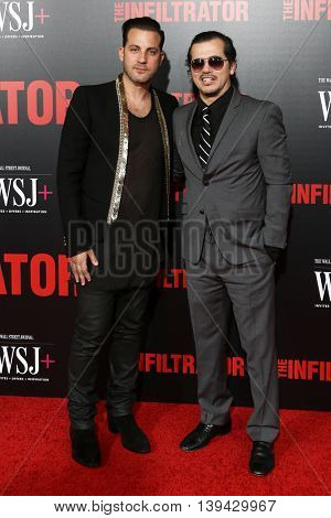 NEW YORK-JULY 11: Director Brad Furman (L) and actor John Luguizamo attend 'The Infiltrator' New York premiere at AMC Loews Lincoln Square 13 Theater on July 11, 2016 in New York City.