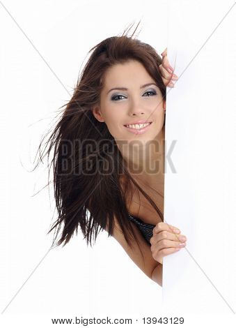 beautiful smiling girl holding a blank billboard.