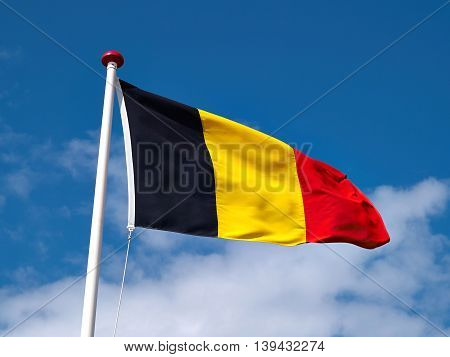 Bright colors flag of Germany up in the air with sky background