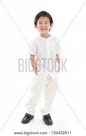 Happy little asian boy in white cothes on white background isolated