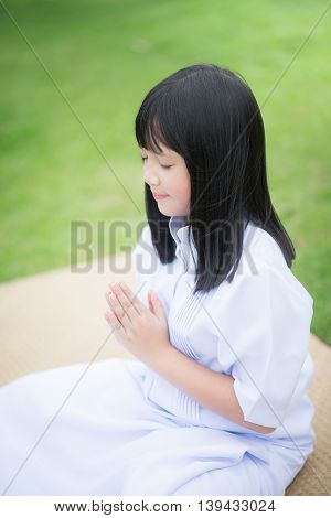 Beautifu Asian girl praying in the park