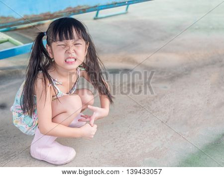asian baby child playing on playground smiling action