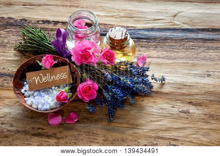 Spa still life with flowers and a tag Wellness