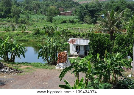 Vietnamese countryside with house next to the fishing pond