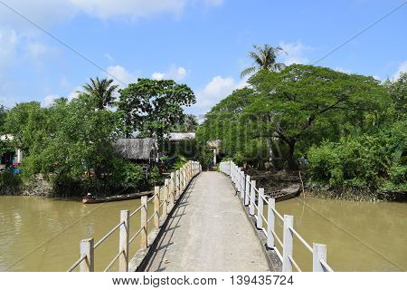 bridge go to river islet in Vietnamese countryside