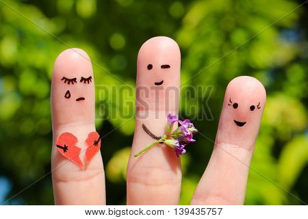 Finger art of family. Man gives bouquet of flowers to another woman. Concept of cheating in relationship.