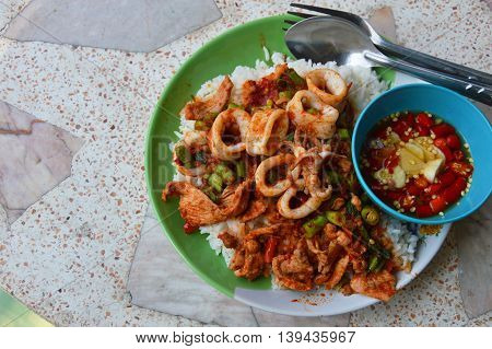 stir-fried curry squid and pork on plain rice