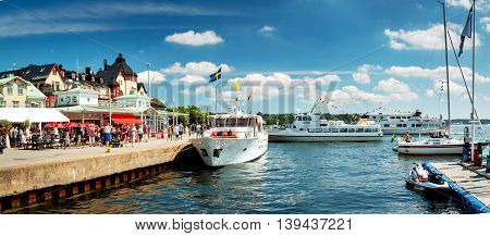 VAXHOLM, SWEDEN - JUNE 25, 2016: Cruise boats at little cosy island Vaxholm near Stockholm