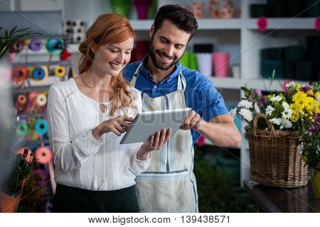 Couple using digital tablet in the flower shop