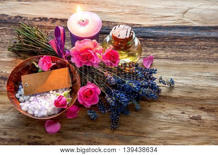 Spa still life with candles, flowers and an empty tag