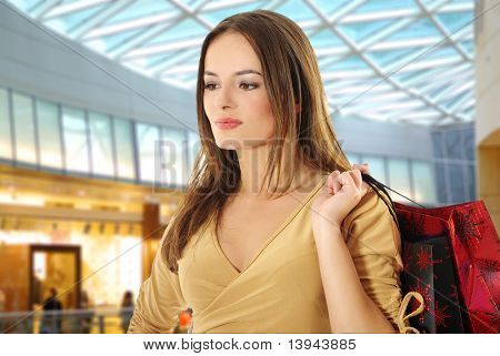 Shopping young woman smiling in the shopping mall.