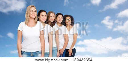 friendship, diverse, body positive and people concept - group of happy different size women in white t-shirts over blue sky and clouds background