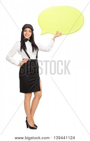 Full length portrait of a joyful woman holding a big yellow speech bubble isolated on white background