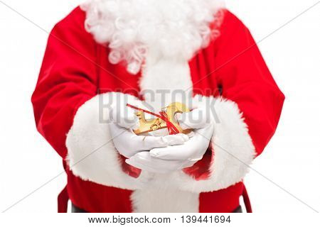 Close-up shot of Santa Claus holding a key with a red ribbon isolated on white background